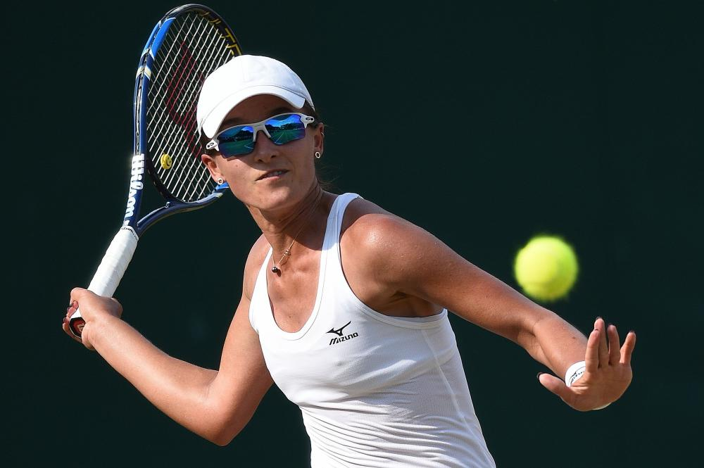 Australia's Arina Rodionova, seen in action during the 2017 Wimbledon Championships at The All England Lawn Tennis Club in Wimbledon, dumped the defending champ Duan Yingying in the first round of Jiangxi Open in China on Tuesday. — AFP