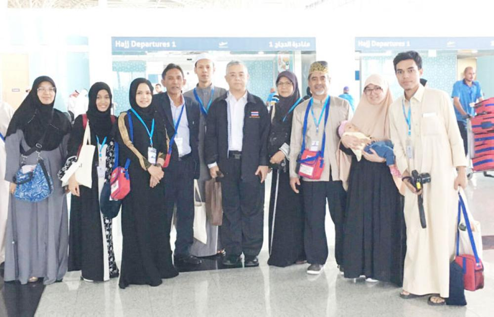 "Thai Consul-General, Thanis Na Songkhla, and officers from the Royal Thai Consulate General in Jeddah and various concerned Thai authorities collaborating under ""Team Thailand"", welcomed the pilgrims at the arrival terminal."