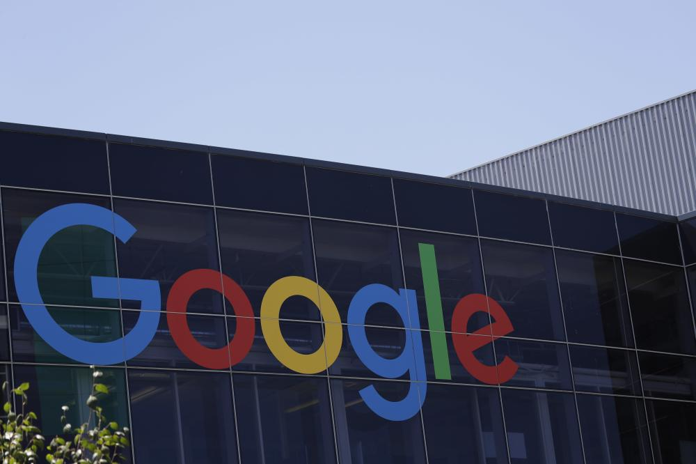 This Tuesday file photo shows the Google logo at the company's headquarters in Mountain View, Calif. Alphabet Inc., the parent company of Google, reported fine earnings on Monday. — AP
