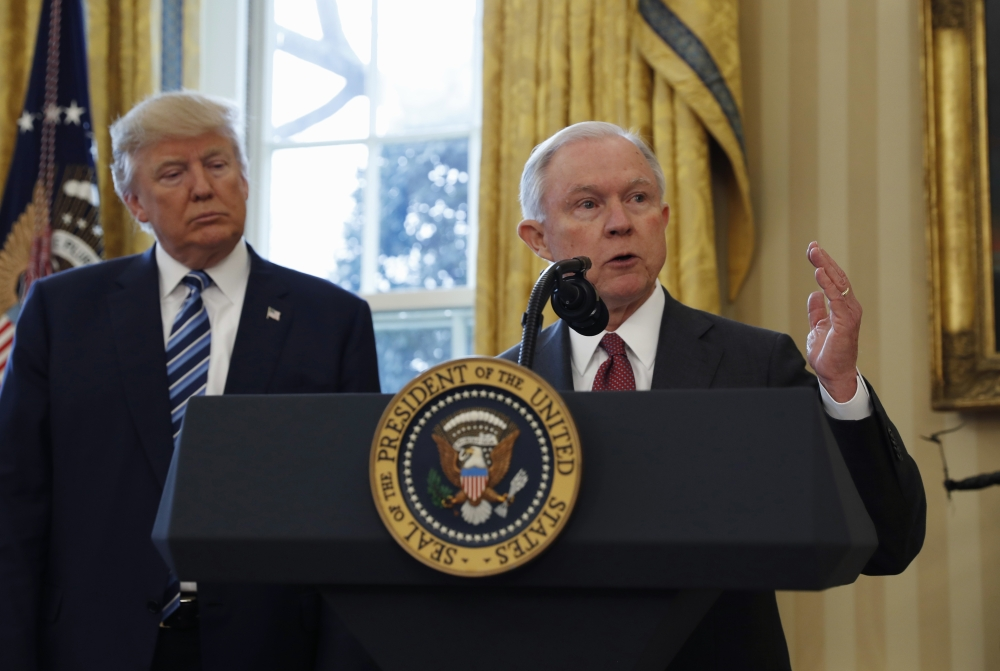 President Donald Trump listens as Attorney General Jeff Sessions speaks in the Oval Office of the White House in Washington after Vice President Mike Pence administered the oath of office to Sessions in this Feb. 9, 2017 file photo. — AP