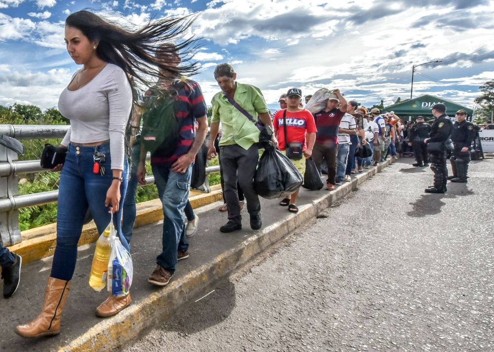 Venezuelan citizens cross the Simon Bolivar international bridge from San Antonio del Tachira, Venezuela to Cucuta, Norte de Santander Department, Colombia, on Tuesday. — AFP
