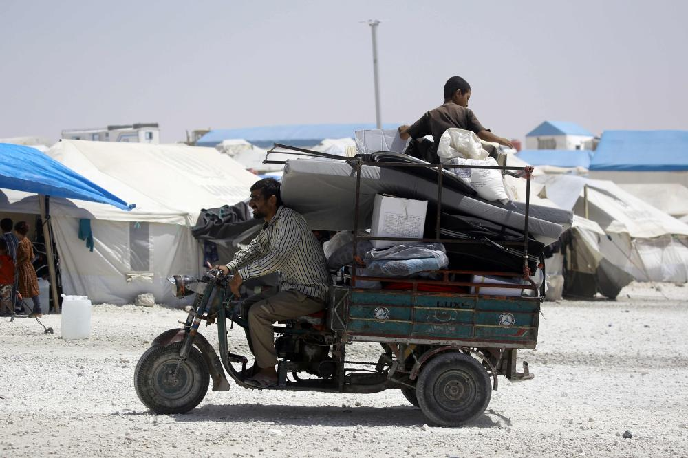 A displaced Syrian man, who fled the countryside surrounding Daesh (the so-called IS) group stronghold of Raqqa, drives his tuktuk at a temporary camp in the village of Ain Issa. — AFP