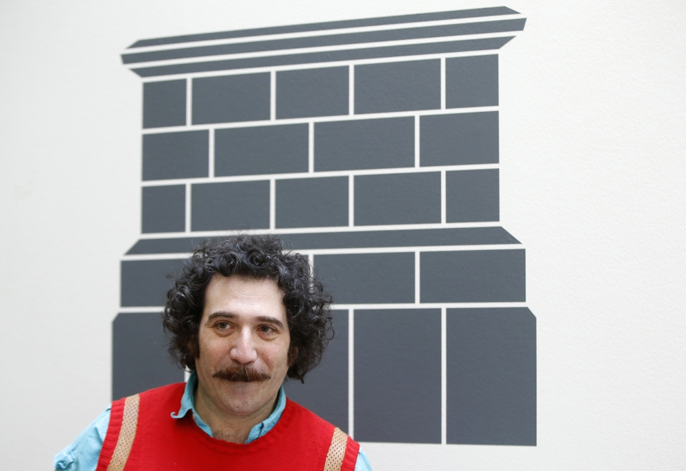 Iraqi-American artist Michael Rakowitz poses for the media at the National Gallery in London in this March 21, 2017, file photo. Rakowitz, is launching a 10-part radio broadcast that features voices of Philadelphia-area Iraqi refugees, Iraq war veterans and Bahjat Abdulwahed, the so-called