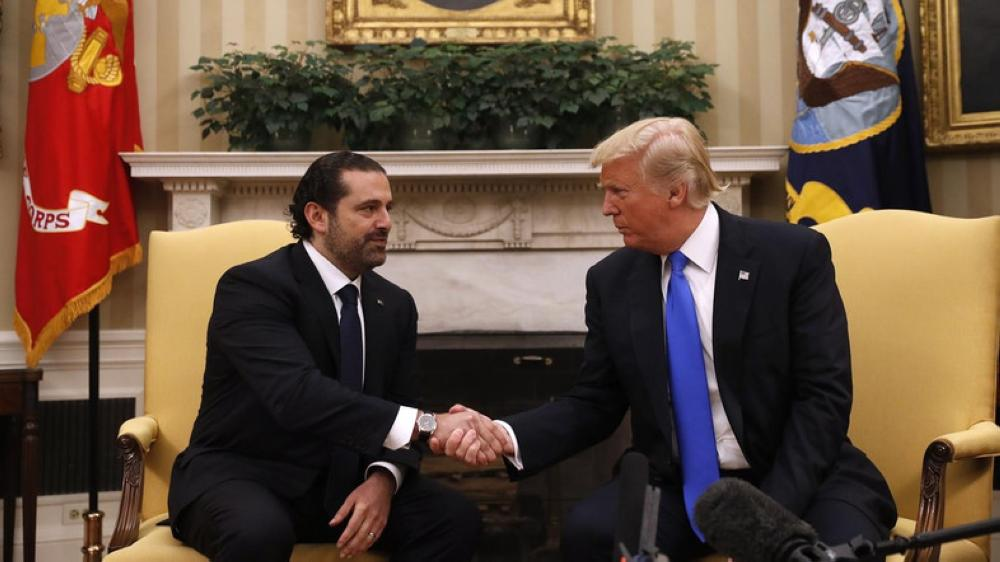 President Donald Trump shakes hands with Lebanese Prime Minister Saad Hariri during their meeting in the Oval Office of the White House in Washington, Tuesday. — AP