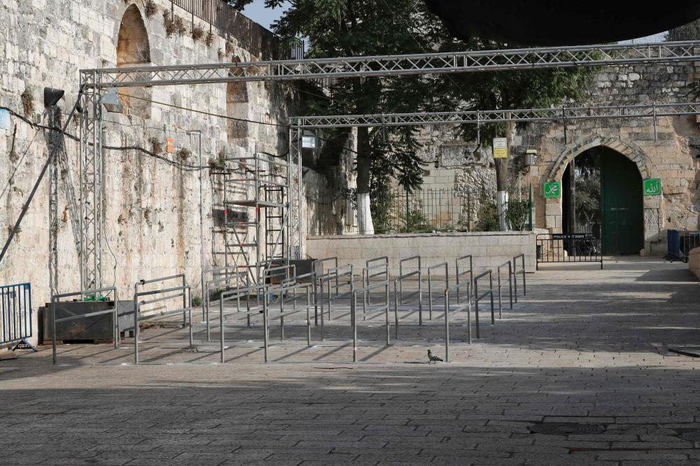 A picture shows a main entrance to the Al-Aqsa Mosque compound in occupied Jerusalem after Israeli security forces removed metal detectors from the site. — AFP