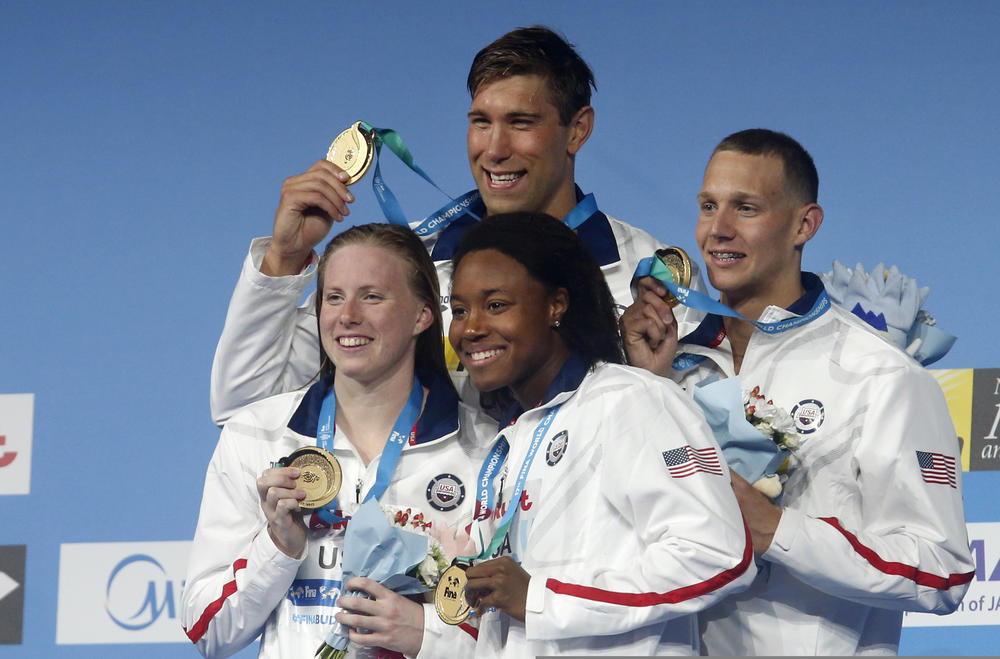 United States' (from L) Lilly King, Matt Grevers, Simone Manuel and Caeleb Dressel pose with their gold medals in the mixed medley relay during the swimming competitions of the World Aquatics Championships in Budapest, Hungary, Wednesday. — AP