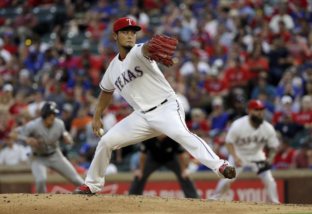 Texas Rangers' Yu Darvish of Japan throws to the Miami Marlins during their MLB game in Arlington Wednesday. — AP