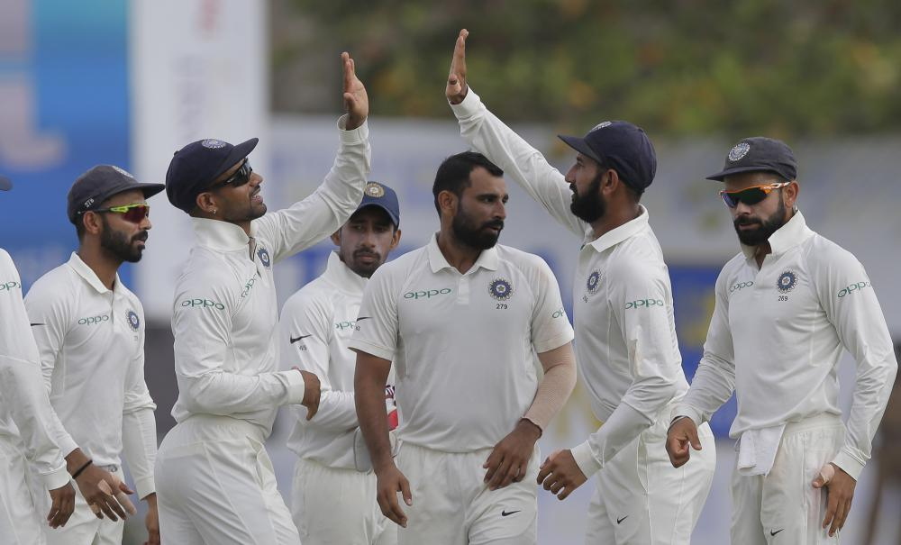 India's bowler Mohammed Shami (C) and teammates celebrate the dismissal of Sri Lanka's Kusal Mendis during the second day's play of the first Test cricket match in Galle, Sri Lanka, Thursday. — AP
