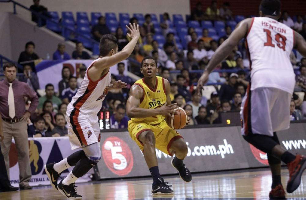 Star import Malcolm Hill is hounded by Alaska's Kevin Racal (L) with LaDontae Henton  all set to join the action in the nightcap of the PBA Governors' Cup at the Ynares Sports Center in Antipolo Friday night.