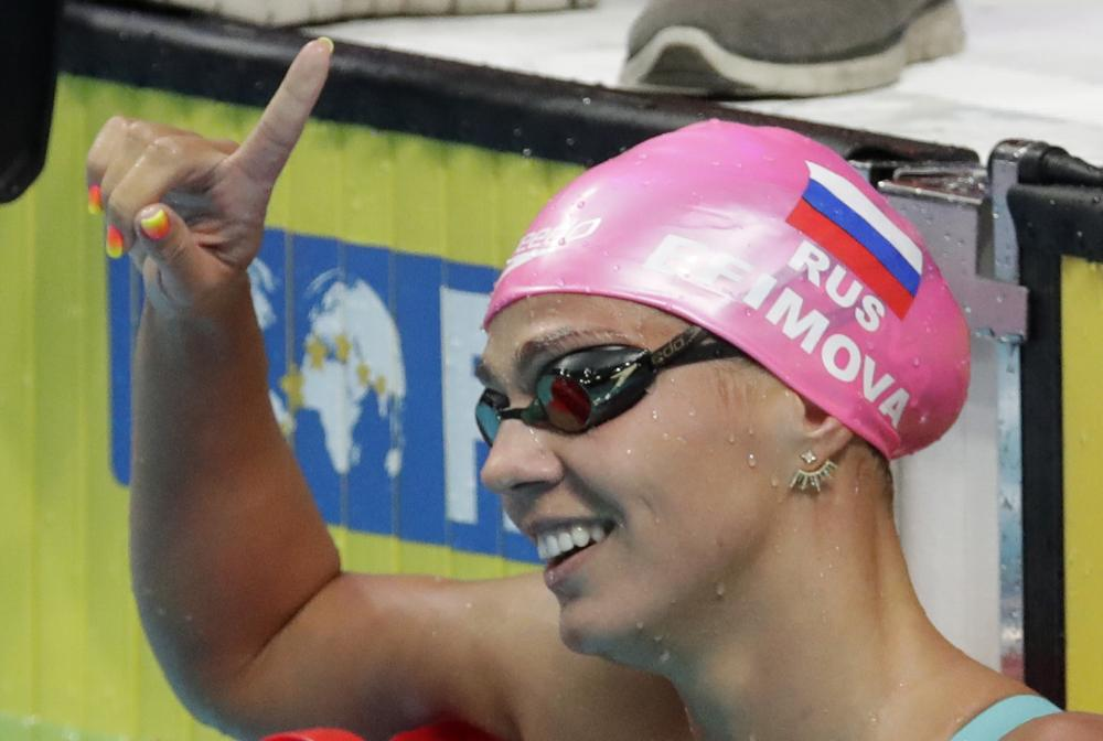 Russia's Yuliya Efimova celebrates after winning the gold medal in the women's 200m breaststroke final during the swimming competitions of the World Aquatics Championships in Budapest, Hungary, Friday. — AP