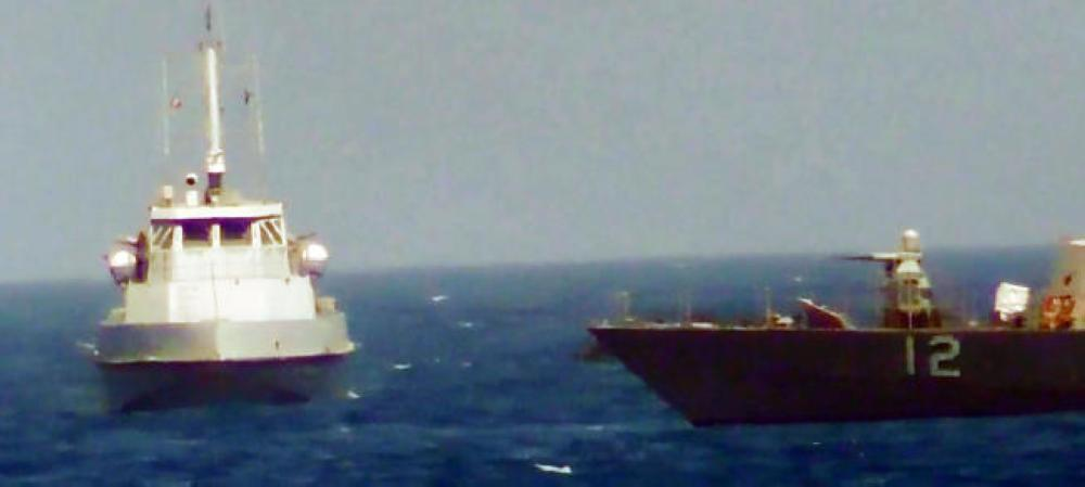 This video grab still image obtained on July 25, 2017, courtesy of the US Navy, shows an IRGCN boat heading toward the USS Thunderbolt in the Arabian Gulf. — AFP