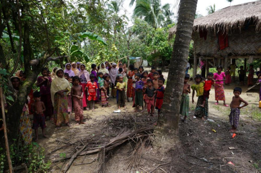 Rohingya villagers watch as international media visit Maung Hna Ma village, Buthidaung township, northern Rakhine state, Myanmar, in this July 14, 2017 file photo. — Reuters