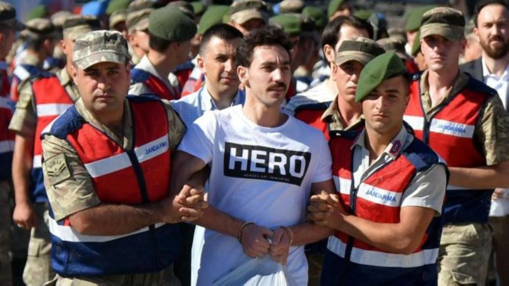 Turkey's Erdogan demands coup defendants wear brown uniforms after 'Hero' t-shirt row