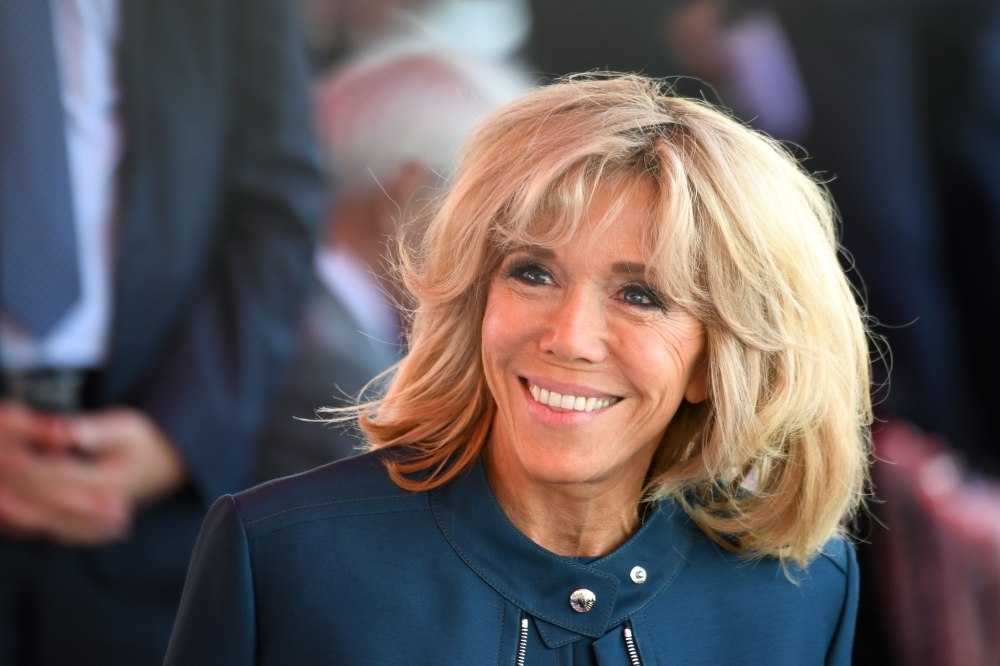 Brigitte Macron, wife of French President, smiles ahead of the start of the annual Bastille Day military parade on the Champs-Elysees avenue in Paris, France, in this July 14, 2017 file photo. — AFP