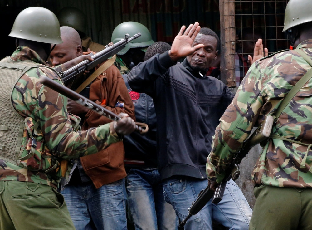 Anti-riot policemen disperse protesters in Mathare, in Nairobi, Kenya, on Wednesday. — Reuters