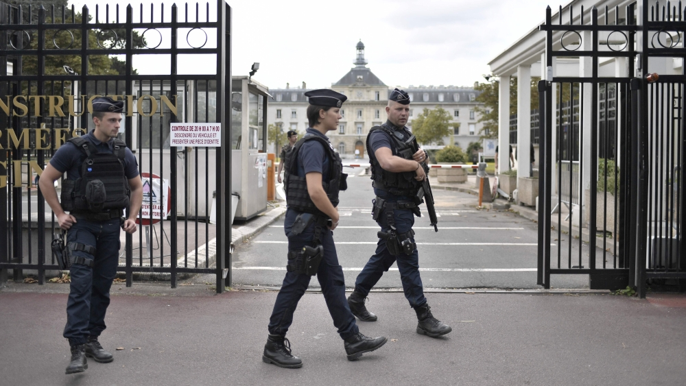 Armed French police officers stand at the entrance of the Begin Military Teaching Hospital in Saint-Mande, outside Paris, where the French soldiers injured earlier in the morning in Levallois-Perret are being treated. — AFP