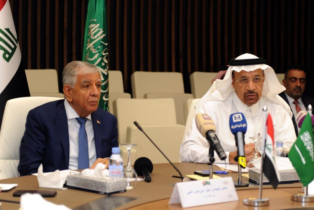 Minister of Energy, Industry and Mineral Resources Khalid Al-Falih, right, and Iraqi Oil Minister Jabbar Al-Luaybi hold a joint press conference in the Jeddah on Thursday. — AFP