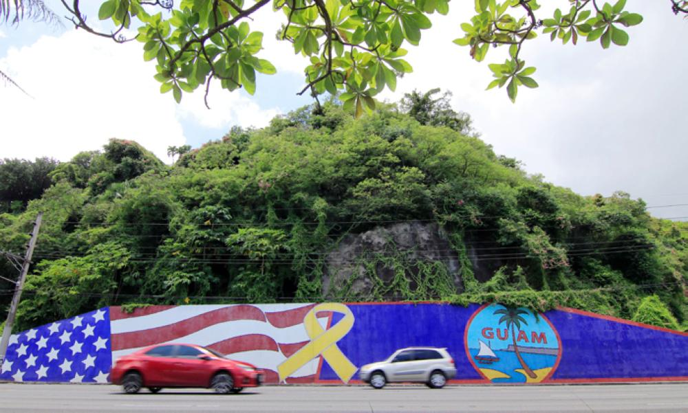 Afternoon traffic passes in front of a wall painted with US and Guam flags in the Tumon district on the island of Guam. Tourism-dependent Guam is looking to cash in on its new-found fame as a North Korean missile target, tapping an unlikely promotional opportunity to attract visitors to the idyllic island and prove that all publicity is good publicity. — AFP photos
