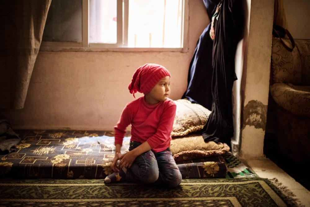Fatima Hadeed, 7, a leukemia patient, in the apartment where her family lived in the Mezze 86 neighborhood of Damascus. — All photos by The New York Times