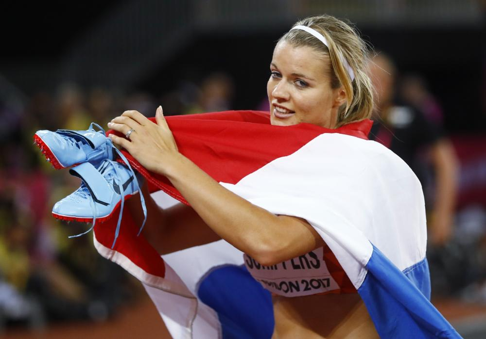 Dafne Schippers of Netherlands celebrates after winning gold in the 200m of the World Athletics Championships in London Friday. — Reuters