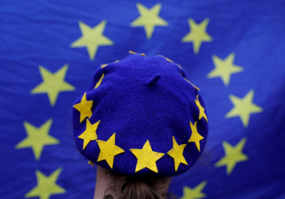 A protester wears a European Union flag themed beret takes part in an anti-Brexit demonstration after Britain's Prime Minister Theresa May triggered the process by which the United Kingdom will leave the Euopean Union, in Birmingham, Britain, in this March 29, 2017 file photo. — Reuters