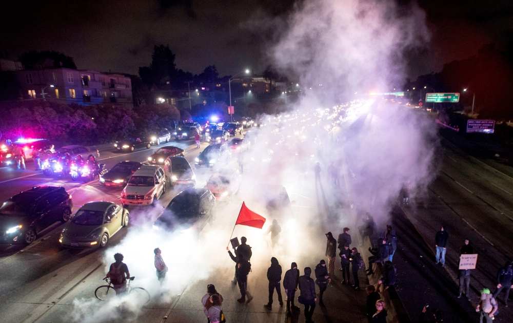 Protesters block both directions of the Interstate 580 freeway during a rally against racism in Oakland, California, on Saturday. — AFP