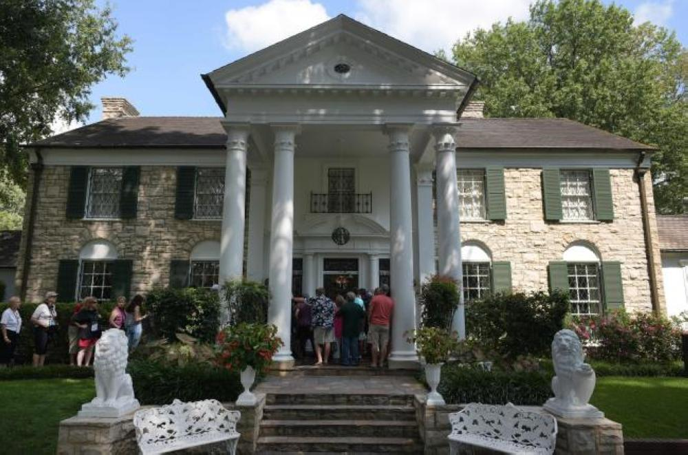 Visitors queue to enter the Graceland mansion of Elvis Presley in Memphis, Tennessee, on Saturday. — AFP