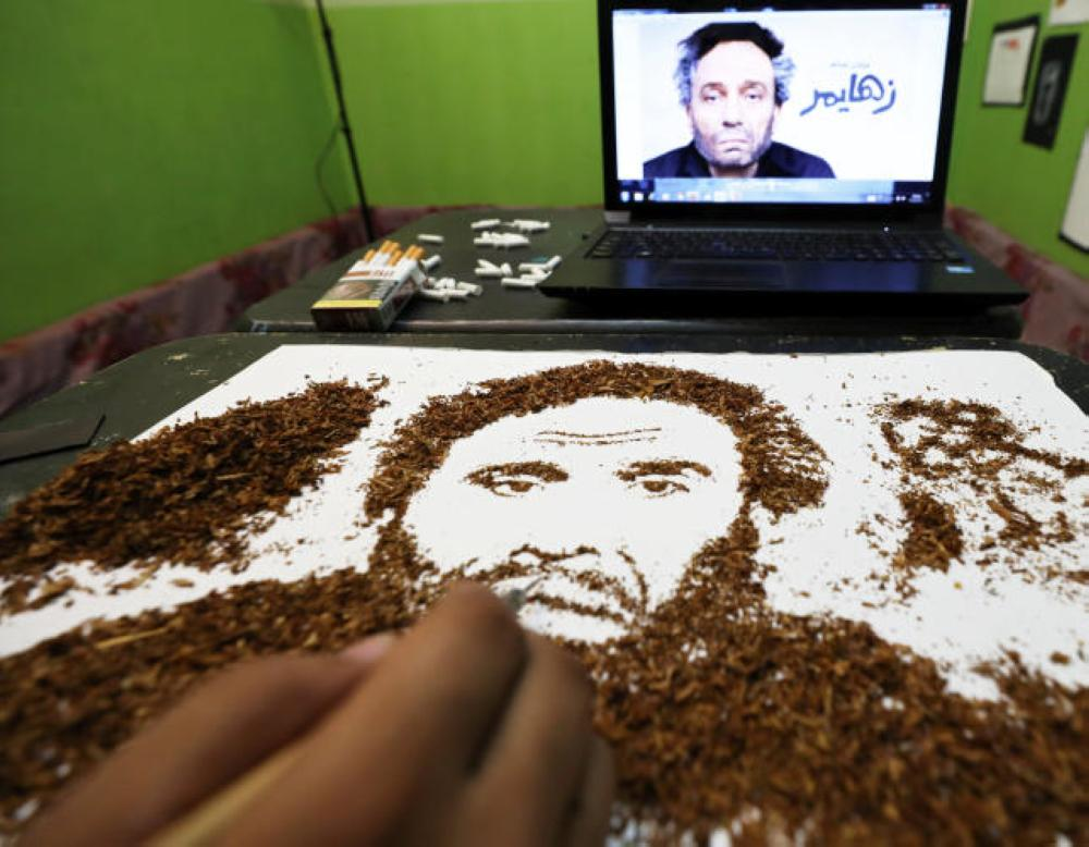Artist Abdelrahman Al-Habrouk creates a portrait of the Egyptian actor Adel Imam with tobacco in Alexandria, Egypt, in this Aug. 10, 2017 file photo. — Reuters