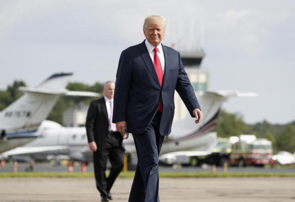 President Donald Trump walks from Marine One to board Air Force One at Morristown Municipal Airport, in Morristown, New Jersey, on Monday. — AP