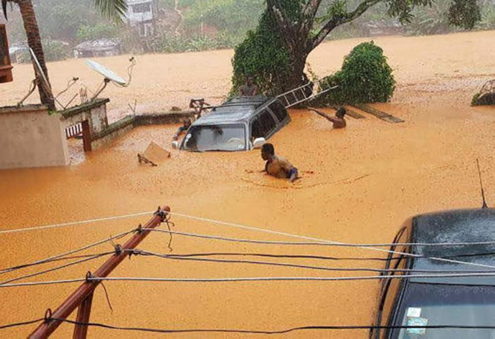 This handout picture released on Monday, by Society 4 Climate Change Communication Sierra Leone, shows flooded streets in Regent near Freetown. — AFP