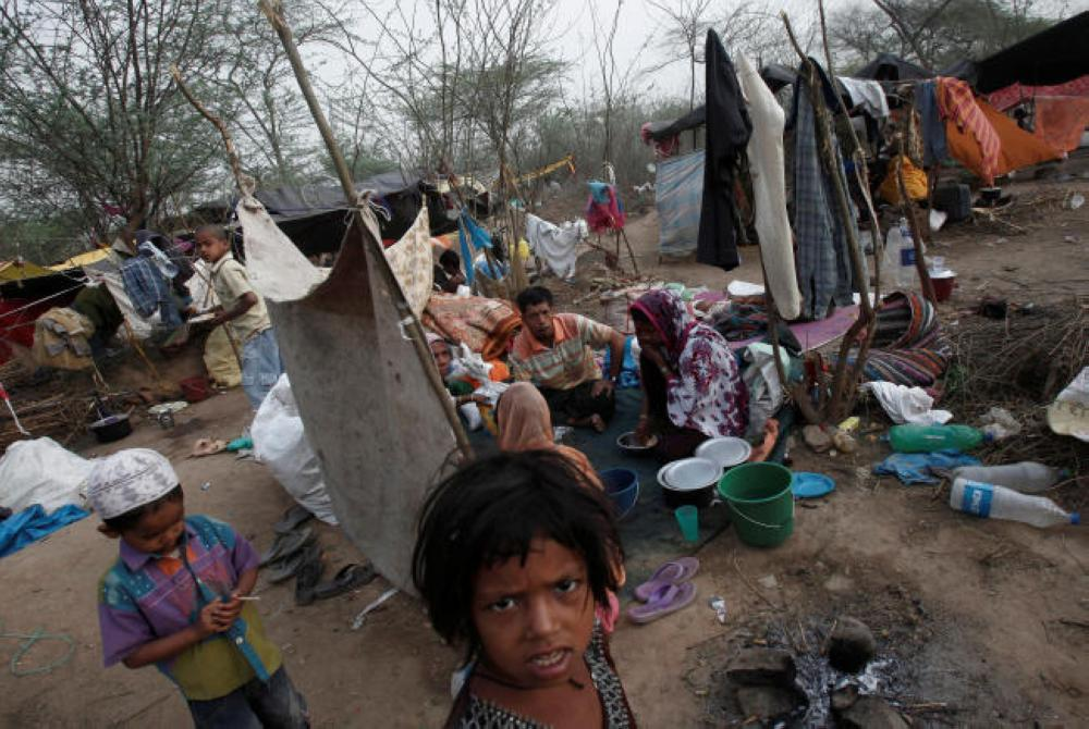 Caption: A family, who says they belong to the Rohingya community from Myanmar, eats their breakfast at a makeshift shelter in a camp in New Delhi in this May 14, 2012 file photo. — Reuters