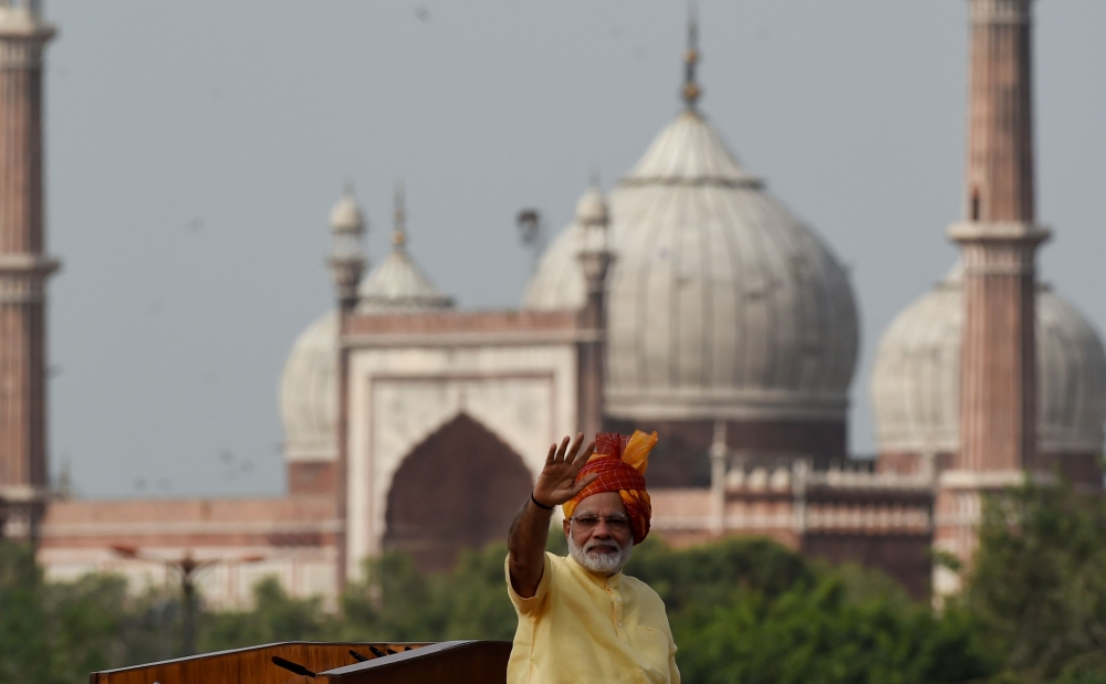Indian Prime Minister Narendra Modi gestures to the crowd after delivering his speech for the country's 71st Independence Day celebrations, which marks the 70th anniversary of the end of British colonial rule, at the historic Red Fort in New Delhi on Tuesday. — AFP