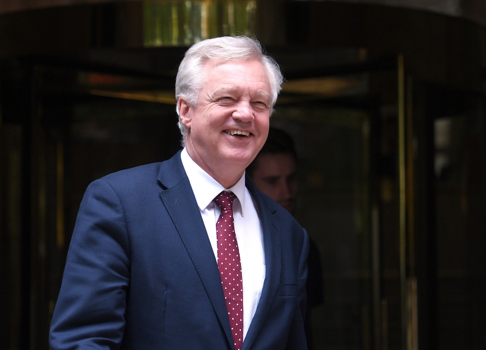 Brexit Secretary David Davis leaves a television studio in central London, Britain, on Tuesday. — Reuters