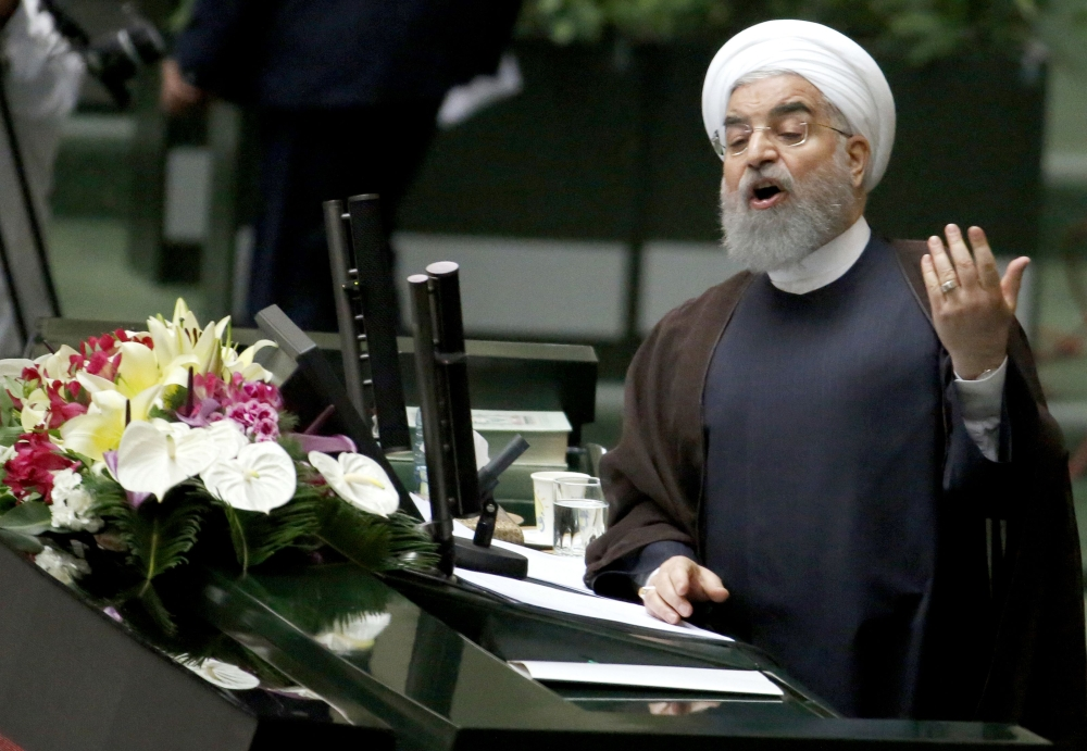 Iranian President Hassan Rohani addresses the parliament in Tehran, Tuesday. — AFP