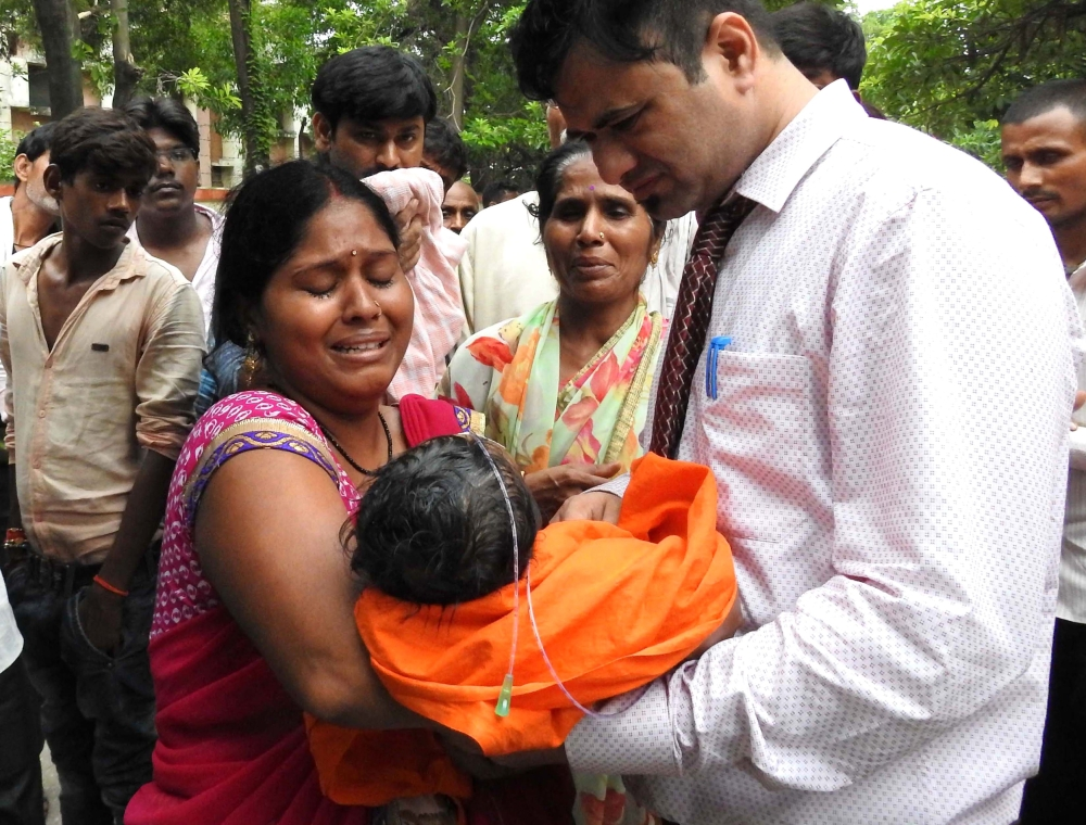 Relatives mourn the death of a child at the Baba Raghav Das Hospital in Gorakhpur, in the northern Indian state of Uttar Pradesh, in this Aug. 12, 2017 file photo. — AFP