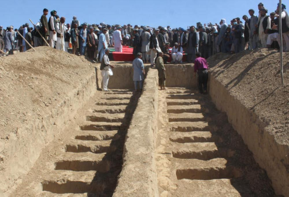 Graves are prepared for the burial of civilians, who were killed by insurgents at Mirza Olang village, in Sar-e Pul province, Afghanistan, on Wednesday. — Reuters