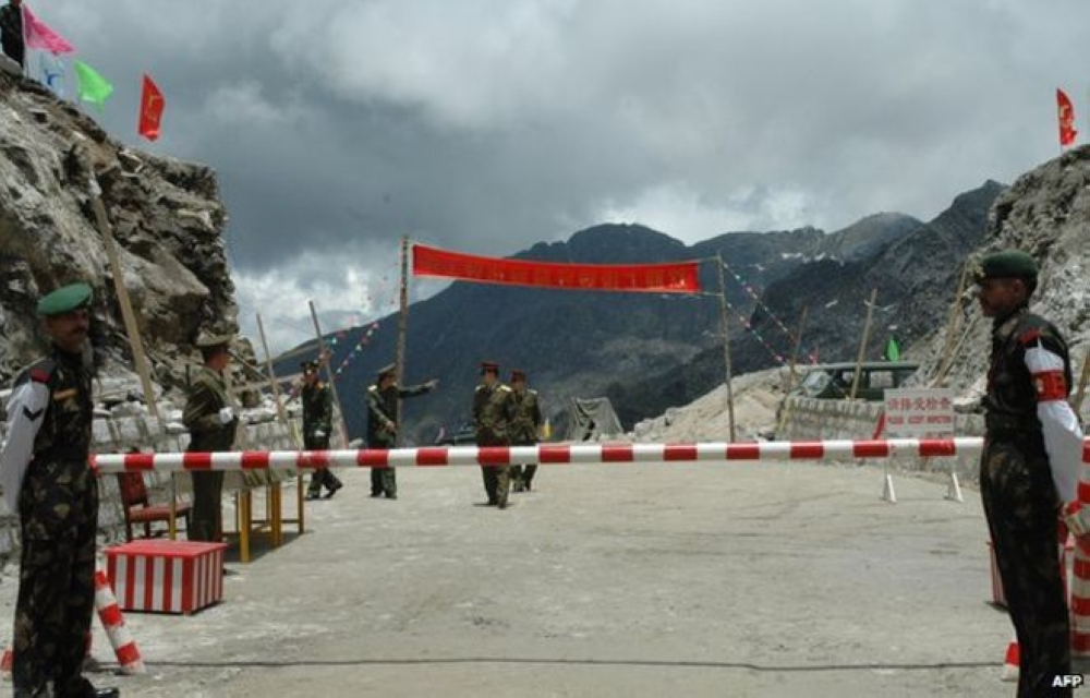 Indian and Chinese soldiers guard border in this file photo. — AFP