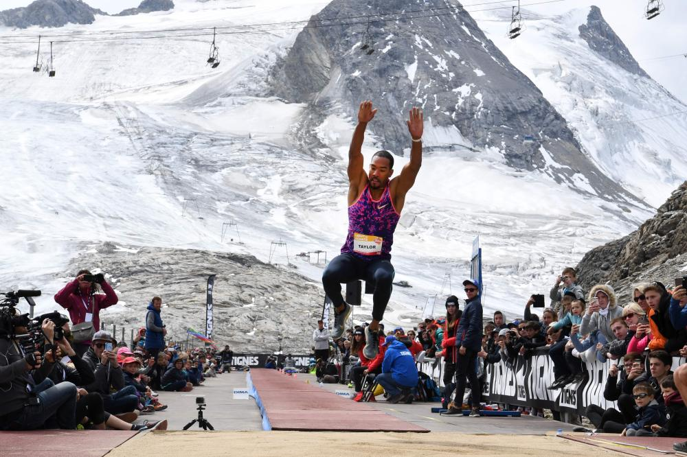 "Christian Taylor of the US competes in the men's triple jump during ""The Jump of the Giants"" Tignes Athletics Open at the foot of the Tignes glacier, 3032m high, in Tignes, French Alps, Wednesday. — AFP"