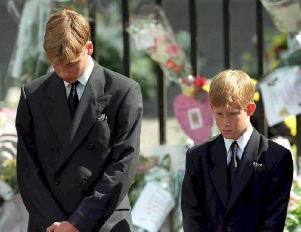 Britain's Prince William, left, and Prince Harry, the sons of Diana, Princess of Wales, bowing their heads as their mother's coffin is taken out of Westminster Abbey, following her funeral service, in this Sept. 6, 1997 file photo. — AFP