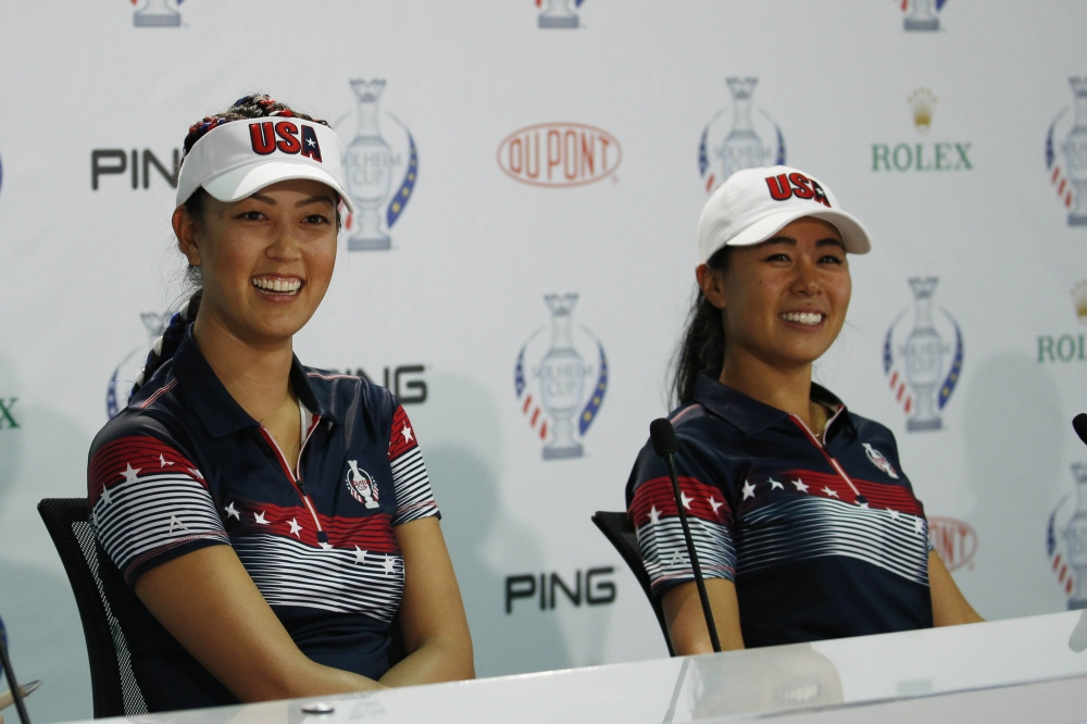 American players Michelle Wie and Danielle Kang participate in a press conference during the second practice round for The Solheim Cup international golf tournament at Des Moines Golf and Country Club. — Reuters