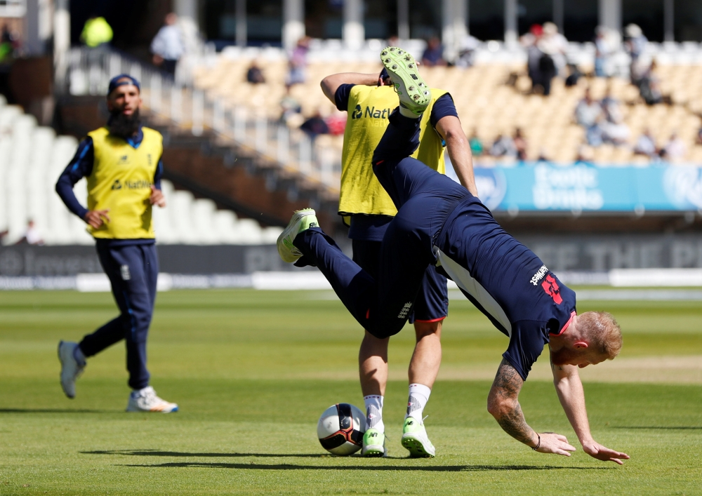 England's Ben Stokes plays football during the warm up before the start of the first Cricket Test at Edgbaston, Birmingham, on Wednesday. — Reuters