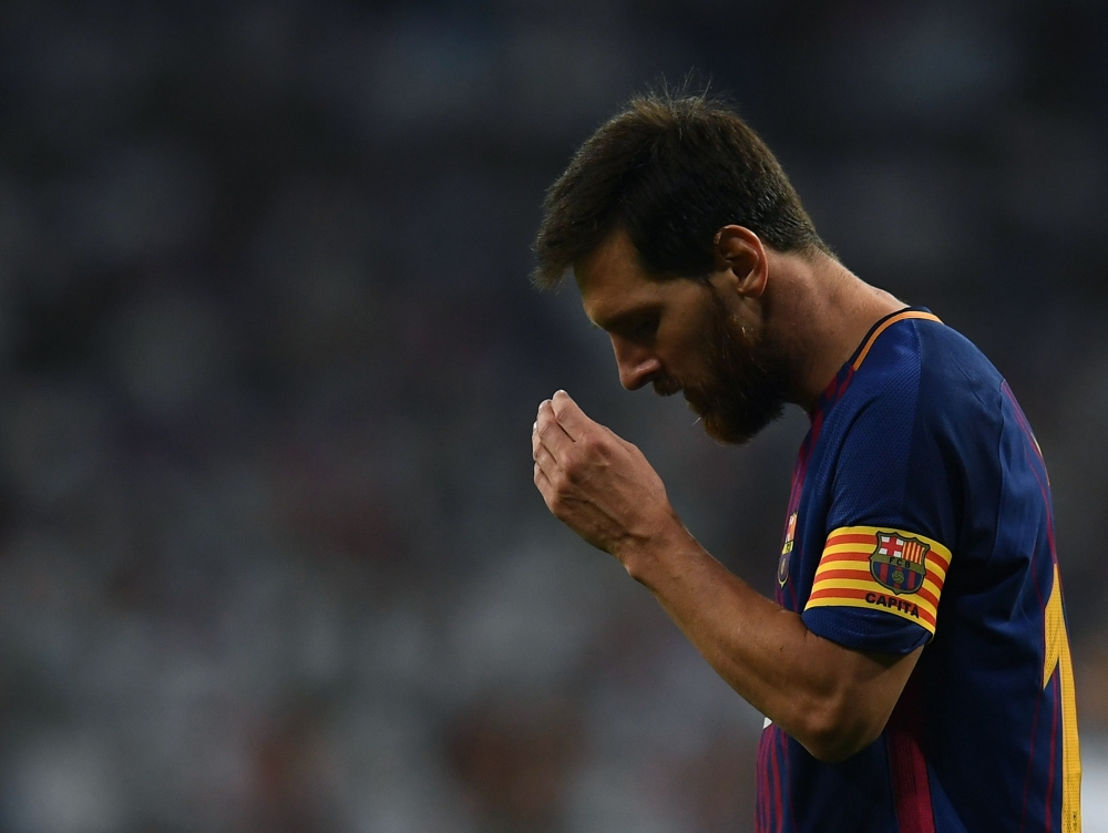 Barcelona's Argentinian forward Lionel Messi gestures during the second leg of the Spanish Supercup football match against Real Madrid at the Santiago Bernabeu stadium in Madrid, on Wednesday. — AFP