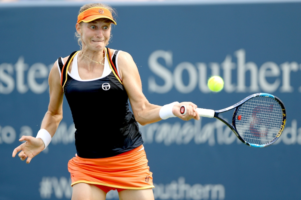 Ekaterina Makarova of Russia returns a shot to Angelique Kerber of Germany during day 5 of the Western & Southern Open at the Lindner Family Tennis Center on Wednesday in Mason, Ohio. — AFP
