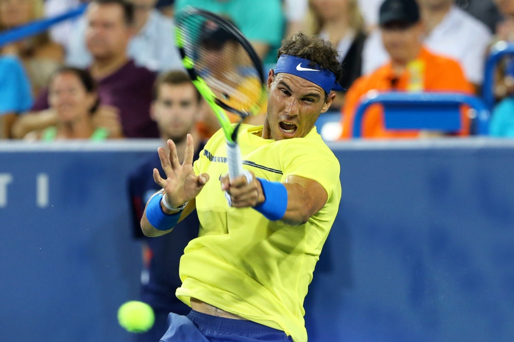 Rafael Nadal returns a shot against Richard Gasquet during the Western and Southern Open at the Lindner Family Tennis Center. — Reuters