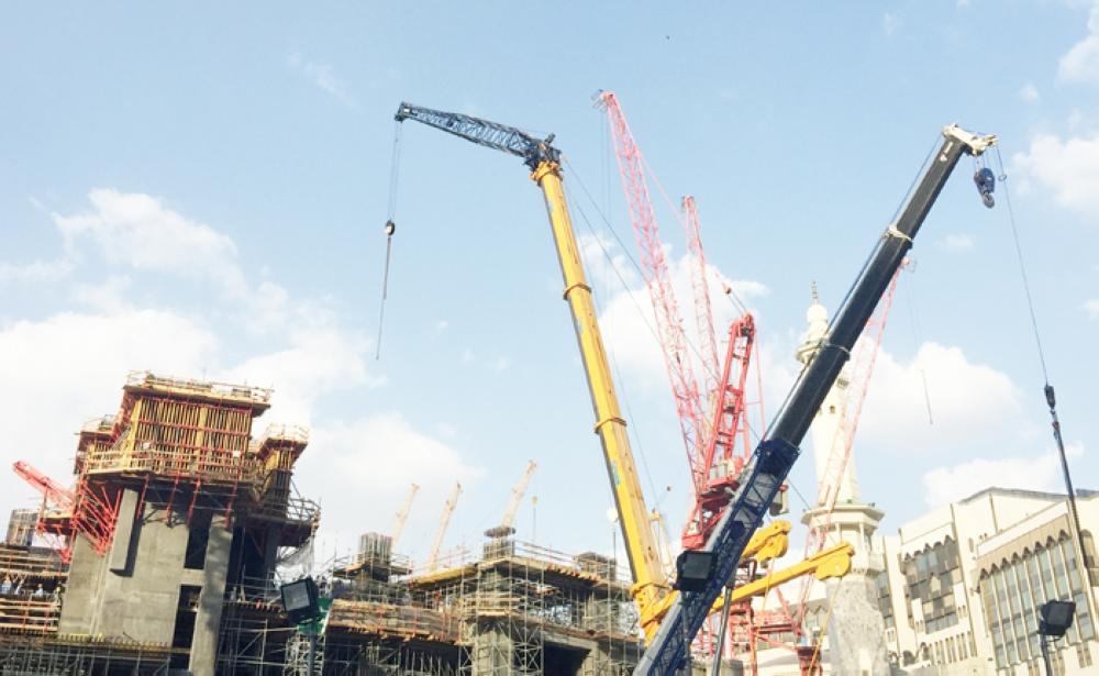 Construction cranes are seen outside the Grand Mosque in the holy city of Makkah. — Reuters