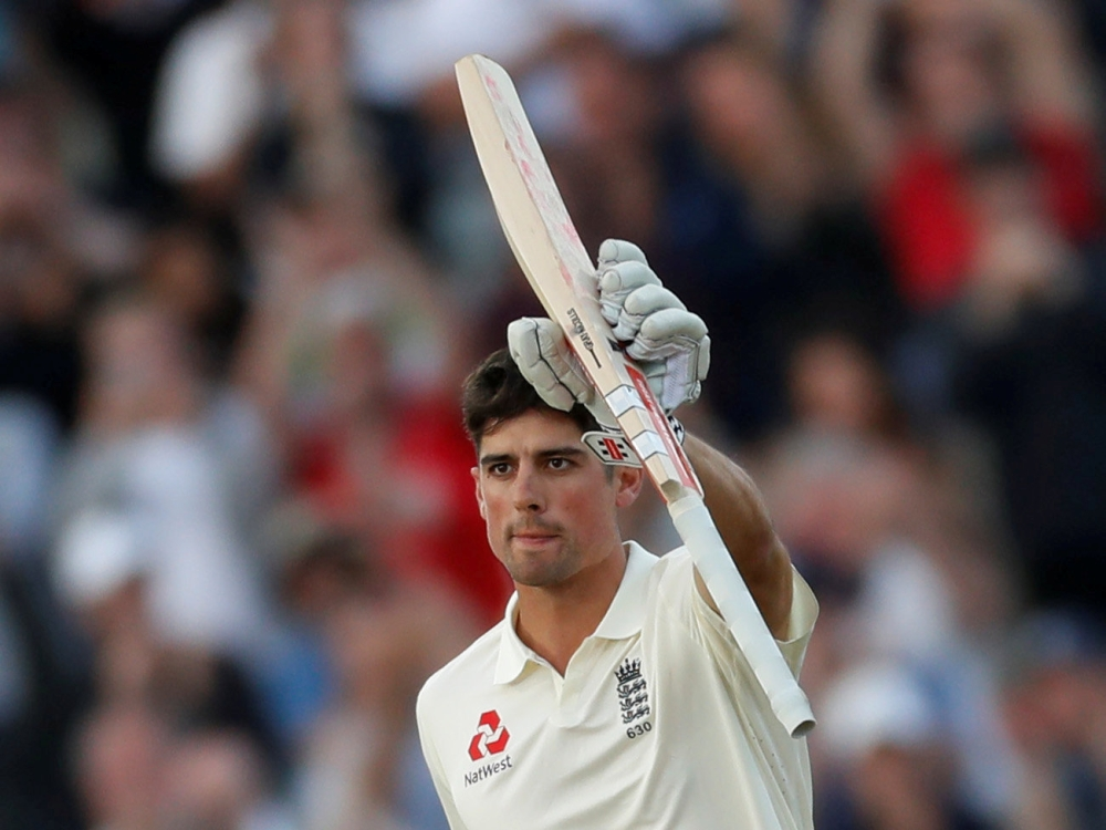 England's Alastair Cook celebrates scoring his century against West Indies in the first cricket Test in Birmingham, Britain, on Thursday. — Reuters