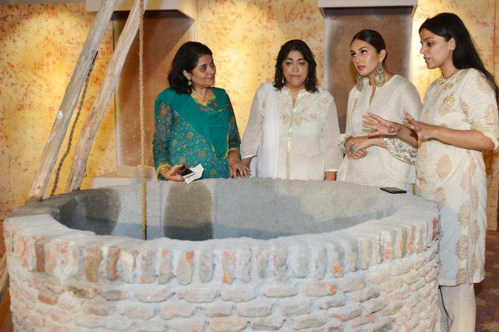 Indian bollywood actress Huma Qureshi (2R) along with director Gurinder Chadha (2L), Chairperson of the Partition museum Kishwar Desai (L) and CEO of the Partition Museum Mallika Ahluwalia talk during a promotional event for the forthcoming Bollywood film 'Partition 1947', at Partition Museum in Amritsar, on Wednesday. — AFP