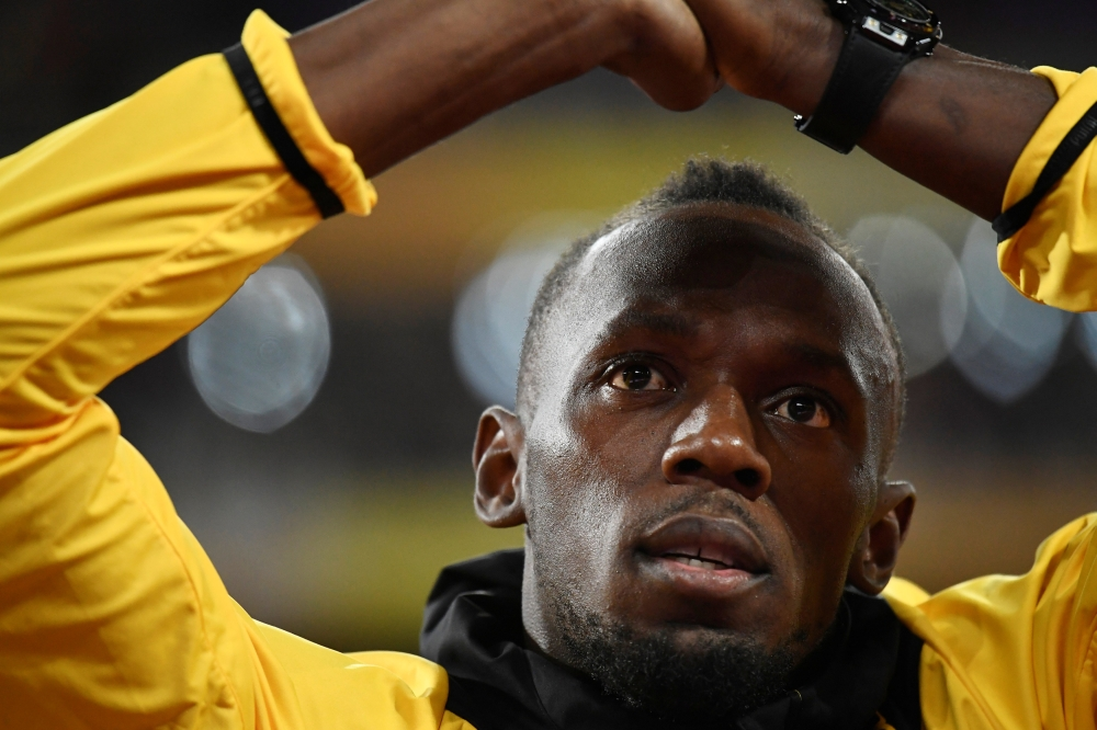 File photo shows Usain Bolt of Jamaica applauding fans during a lap of honor at the London Stadium at the World Athletics Championships in London. — Reuters