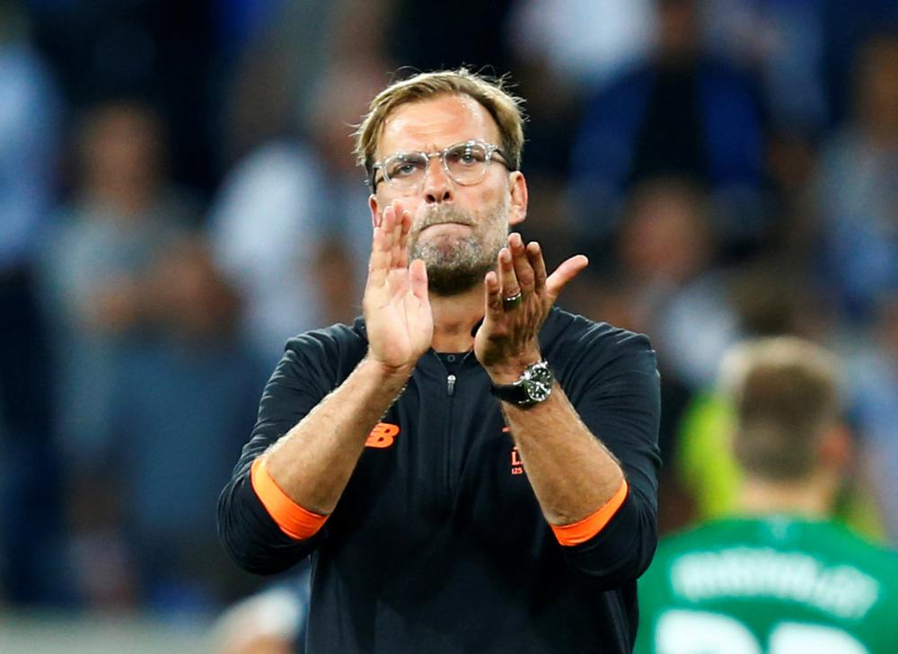 FIle photo shows Liverpool manager Juergen Klopp applauding fans after a match against Hoffenheim in Germany. — Reuters