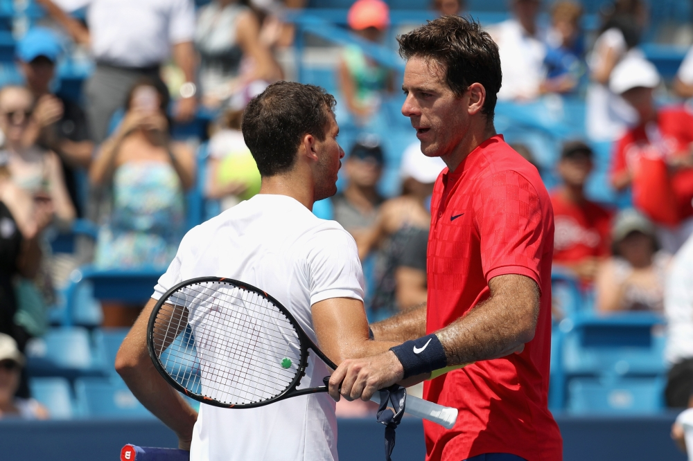 Grigor Dimitrov of Bulgaria, left, and Juan Martin Del Potro of Argentina shake hands after Dimitrov defeated him during Day 6 of the Western and Southern Open at the Linder Family Tennis Center on Thursday in Mason, Ohio. — AFP